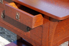 Dovetail drawer construction and accurate replica hardware.